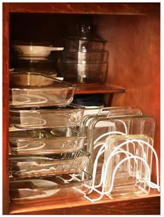 "pans These ""pan holders/organizers"" are from Amazon. It's a great way to utilize your space. -(especially for your glass bakeware)"