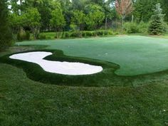 You can master your golf game and sink the fifteen foot putts. Your very own sand bunker too. Synthetic putting green. Holly Krevitz Designs. Backyard Putting Green, Putt Putt, Bunker, Golf Courses, Sink, Vessel Sink, Miniature Golf, Sink Tops, Bomb Shelter