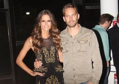 Paul Walker and model Izabel Goulart pose for photos backstage before the post parade party for the brand Colcci during Sao Paulo Fashion Week Summer 2013/2014 in Sao Paulo.