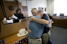 Gerald Gafford, right, holds his partner of over 28 years, Jeff Sralla, after he was overcome with emotion when Travis County District Judge Amy Clark Meachum said she would sign the 72-hour waiting period waiver following the Supreme Court Ruling allowing same sex marriage in the U.S. on Friday, June 26, 2015, in Austin, Texas. The men plan to marry at their church on Sunday. (Deborah Cannon/Austin American-Statesman via AP) AUSTIN CHRONICLE OUT,   Photo of the Day - Yahoo Celebrity…