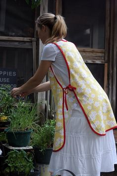 I love aprons over dresses and skirts. great for keeping the skirt mess free with our very busy days! Denim Aprons, Sewing Aprons, Plain Dress, Dress Up, Women's Clothes, Clothes For Women, Pinafore Apron, Apron Patterns, Cute Aprons