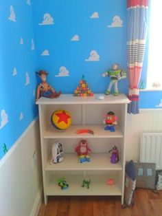 Toy Story themed nursery, she designed her little boys room to look just like andys from toy story. she used beadboard wallpaper and dado rail to look like wood and then sky paint with some cloud stickers she found on ebay. delighted with the way it turned out, she designed and painted the pixar ball using an elastic band to make it even, Nurseries Design