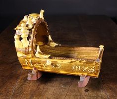 Lot 214 - A Late Century Halifax Slipware Cradle dated May with birds to the hood of the cradle. Carriage Bed, May 12, Antique Pottery, The Saleroom, Nova Scotia, Earthenware, 17th Century, Clocks, Cribs