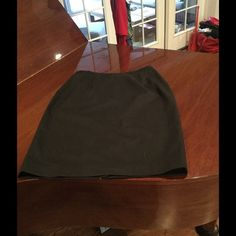 Harve Bernard wool black straight skirt. This is a reposh for me.it is a little too snug.  Great skirt, fully lined light wool blend skirt.  Great work staple.  Hits right below knee.  Has a small stain on the front, barely noticeable.  Size 16.  Likely fits a 14/16 best. Harve Benard Skirts Midi