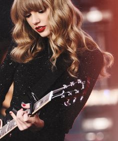 Taylor Swift doing what she does best. I love her way too much.
