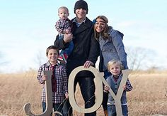 """These big letters are the perfect prop for the family to gather around! You could also spell out your last name or choose another word that's meaningful to you. (Be sure to click through to see their other """"prop"""" as well, an adorable little donkey!)"""