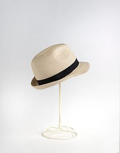 I'm *not* a girl that wears hats well, but some girls look so chic in them. If I could pull it off, I'd wear this with a pair of short, blue and white striped seersucker shorts, a sheer, very light, white linen or cotton button-up, long sleeve, or 3/4 sleeve collared shirt. Sleeves rolled up. A red fabric belt, and a cute pair of wedge espadrilles, peep-toes, in a blue with red accents, or neutral color. Very Hamptons in the Summer, and casually cool over a swimsuit.  August Hats Fedora