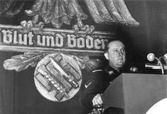 "Richard Walther Darré speaking at a Reichsnährstand assembly in Goslar, 1937. He was one of the leading Nazi ""blood and soil"" (German: Blut und Boden) ideologists. He was appointed by Hitler as Reich Minister of Food and Agriculture. He served in that position from 1933 to 1942. After the war, he was briefly imprisoned and was released in 1950. He died 3 years later."