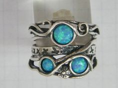 Sterling silver ring set with opal stones. Israeli designer bohemian ring. $69.00, via Etsy.