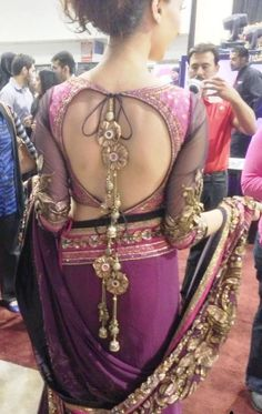 Beads and stones hanging from the ends of the tassel of your dupatta or the bodice do wonders to adorn the bare gaps in the back of your choli or blouse. Think about choosing unique and quirky patterns like this.