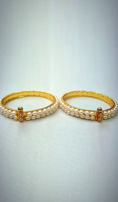 #Bangles & #Bracelets - Pearl Bangles (Set Of 2) Costs Rs. 1,240. #Jewellery. BUY it here: http://www.artisangilt.com/imitation-jewellery-fashion-jewelry/bangles-bracelets/pearl-bangles-set-of-2-32760.html?ref=pin