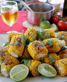 5 sweet corn cobs, leaves and silk removed 70gm butter 1/2 tsp paprika 1 tsp cayenne pepper 1/2 tsp cumin 1 garlic clove, peeled and cut in half 1/2 tsp brown or white sugar 1 tsp salt 1 fresh lime 1/2 tsp black pepper Fresh coriander and more lime for garnish