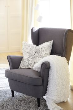 Who needs a reading lamp when you have the sun? Place your favorite reading chair by a window to take advantage of the daylight and save the lamp for sundown.
