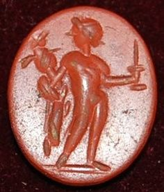 Red jasper intaglio: Diomedes with the Palladion.