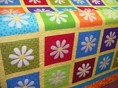 If anyone out there loves me and knows how to quilt, I want one like this but with lots of pink!  ;)