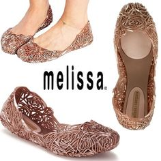 *Melissa Shoes* Blush pink ballet flats NWOT NEVER WORN ballet flats by Melissa Shoes. Super unique open work design. Jelly material perfectly molds to your feet for a crazy comfortable, flexible fit. Will not last long! ONLY selling because I wear a 9.5 and thought these might work but they fit TTS for a 10. Too pretty to keep to myself!! Blush color is gorgeous and the glittery finish makes these shoes extra pretty. Would be a BEAUTIFUL wedding/special occasion flat! Melissa Shoes Shoes…