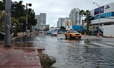 In November 2013, a full moon and high tides led to flooding in parts of the city, including here at Alton Road and 10th Street. Photograph: Corbis