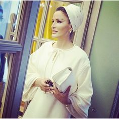 How beautiful.  Love this lady.   #herhighnesssheikhamoza  Another chic day for Sheikha Mozah