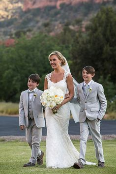 Bride and her sons walking down the aisle | @sedonabride | Brides.com
