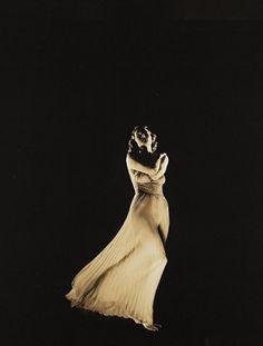 Photo by Edward Steichen, 1937, Vogue, model: G. André.