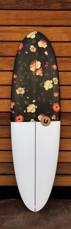 """6'2"""" x 21"""" x 2.65"""" // 40 liters Disc 4+1 with custom Poppy inlay art. PU/PE, glassed 6+4/4oz, Futures 4+1 fin set up, sanded finish. Full round nose, low entry rocker, deep single concave to vee, roun"""
