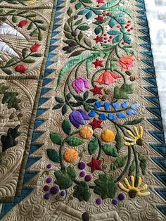 Amazing details in the quilting and also the fabric dyes.  Would like to see it in its entirety.