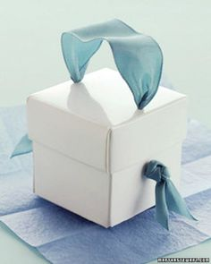 Dress up a gift box with a handle of ribbon threaded through the lid and sides.