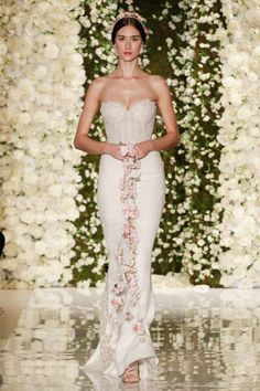 A model walks the runway during the Reem Acra Fall 2015 Bridal Collection show at the Reem Acra Boutique