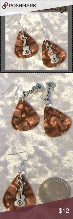 """Copper Pearlescent Acoustic Guitar Pick Earrings These music-themed earrings are made with genuine copper celluloid guitar picks, Tibetan antique silver acoustic guitar charms & silver-plated ear wires & rings. 2"""" with ear wire*. Handcrafted by me.   *Can be replaced w/ Sterling Silver for an additional $1. Comment for a listing.  Jewelry items are priced firm as a single purchase due to material cost & PM fees.   Bundle special on guitar pick /choker/charm jewelry ONLY: Any 2 items for $20…"""