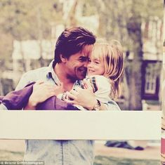 'Dakota and her Daddy!!! 1994': Melanie also posted this cute photo of Dakota and Don on F...
