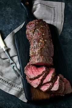 Incredibly Simple Garlic Rosemary Beef Tenderloin Roast recipe. Just season, roast, and slice! Perfect for the holidays