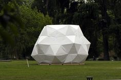 """""""Casa Umbrella"""" is composed of each triangle on a regular icosahedron replaced by an umbrella. The connection detail of the umbrellas is the water cut-off fasteners used for a diving suit, The size of the umbrella is defined based on the spaces to be created. A few umbrellas produces a small roof, while 15 umbrellas can create a shelter. The material of the umbrella surface is a polyester non-woven fabric 'Tyvek' produced by DuPont, which has an outstanding quality in water proofing."""