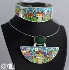 KIMILI offers an exclusive handmade cloisonné enamel jewelry from Georgia. Cloisonné enamel is an ancient metalwork technique that makes use of small, precious metal flaments and colorful glass enamels to create a brilliant artwork. All the jewelry is handmade and exclusive. This pendant was created by a talented designer Deyko. Being a painter she has tried to use her creative thinking on the enamel. Deyko is experimenting with wood, silver and other precious metals. The surrounding nature…