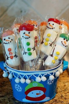 MARSHMALLOW SNOWMEN ON A STICK (Stocking Stuffer) Party favors? Three marshmallows stuck on a stick. Dip in white almond bark. Apply frosting and candy decorations. Food coloring added to white almond bark for hats.