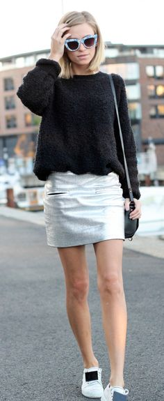 Tine Andrea is wearing a silver skirt and black fuzzy sweater from Nelly, shoes from Acne, the bag is from Givenchy and the sunglasses are from Asos