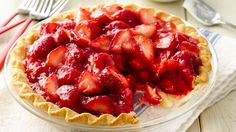 Enjoy this traditional strawberry pie topped with whipped cream – a sweet treat.