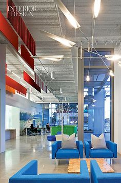 Nokia's Slick Silicon Valley HQ Office.   A David Weeks pendant fixture hangs over Scot Laughton arm-chairs and a Brent Comber table in the lobby.   hight tech company