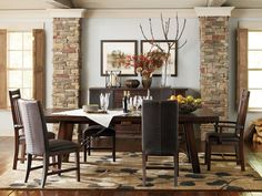 Rustic meets chic in the Arden Ridge collection. Incorporate mahogany solids for enduring style, and add the classic straight lines and felt-lined drawers in the server for timeless elegance. The sepia wall art and neutral-colored rug soften the atmosphere of distressed finishes to create the perfect rustic retreat.