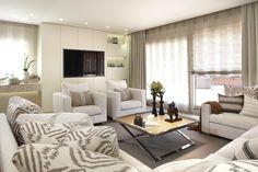 Molins Interiors // arquitectura interior - interiorismo - decoración - salón - sofá - cojines - sillón - butaca - televisor - mesa de centro