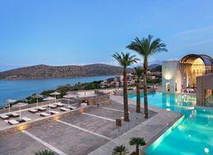Blue Palace, a Luxury Collection Resort & Spa, Crete Greece sky outdoor swimming pool property leisure Resort vacation Sea Beach Ocean resort town bay caribbean Villa real estate marina Lagoon shore