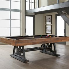"American Heritage Billiards – the world's leading Pool Table, Game Table, Bar and Bar Stool manufacturer – presents the Da Vinci Pool Table. The Da Vinci is the embodiment of the movement of turning old into new again, combining an authentic reclaimed wood body with a classic yet rugged steel frame. Archimedes first demonstrated the use of a screw in 200 B.C. to create a machine to pump water. It was Leonardo Da Vinci in the late 1400's who first demonstrated the use of a ""screw jack"" for…"