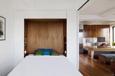 A Murphy bed pulls down to reveal a niche lined in walnut veneer that acts as a headboard.