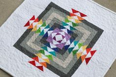 Rainbow HST and Flying Geese quilt