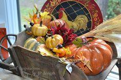 fall in my antique wheel barrow, repurposing upcycling, seasonal holiday decor