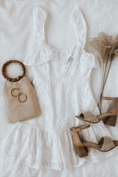 There is so much to love about spring style. It's the perfect time for florals and white dresses, and this  mini dress combines the two. There are eyelets throughout the body and continue along the ruffle neckline. Getting ready for graduation or a bridal shower has never been easier. Just add natural colored raffia heels and a bamboo handle bag. #lovelulus