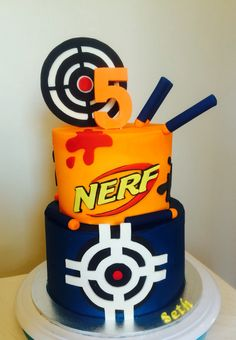 Nerf birthday cake. Buttercream icing. Targets and bullets etc made from fondant.