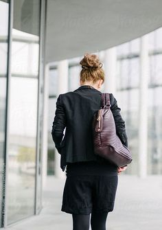 Yuoung blonde Businesswoman walking - from behind.