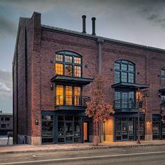 brick facade and turn buckle overhangs in dark paint for nofo condo