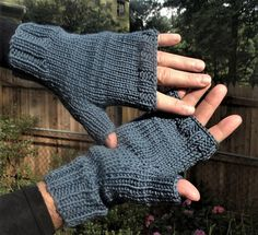Mens fingerless gloves are hand knit in dusty blue 55% merino wool, 33% microfiber and and 12% cashmere yarn. These grayed dusty blue mens fingerless gloves are knit with ribbing at the wrist and knuckles for a close, warm fit, and smooth stockinette stitch throughout the rest of the glove for a classic, tailored look. The combination of merino, microfiber and cashmere crates a squishy fabric that is very soft, durable and warm. This style of mens glove includes a half thumb and one opening…