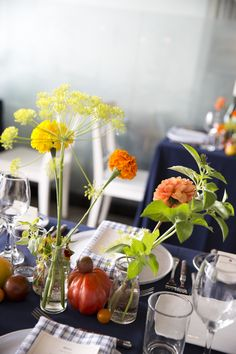 Red and Orange Flowers with Navy Red orange & yellow flowers with tomatoes by @mimosafloral .  Amazing photos by @Joshstrauss from our pop up dinner on July 22. Southern Italian Food and Ambiance.  Yum!